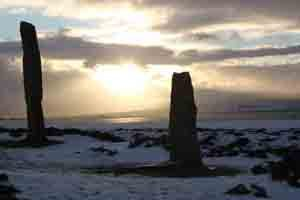 Standing stones snow and sunlight